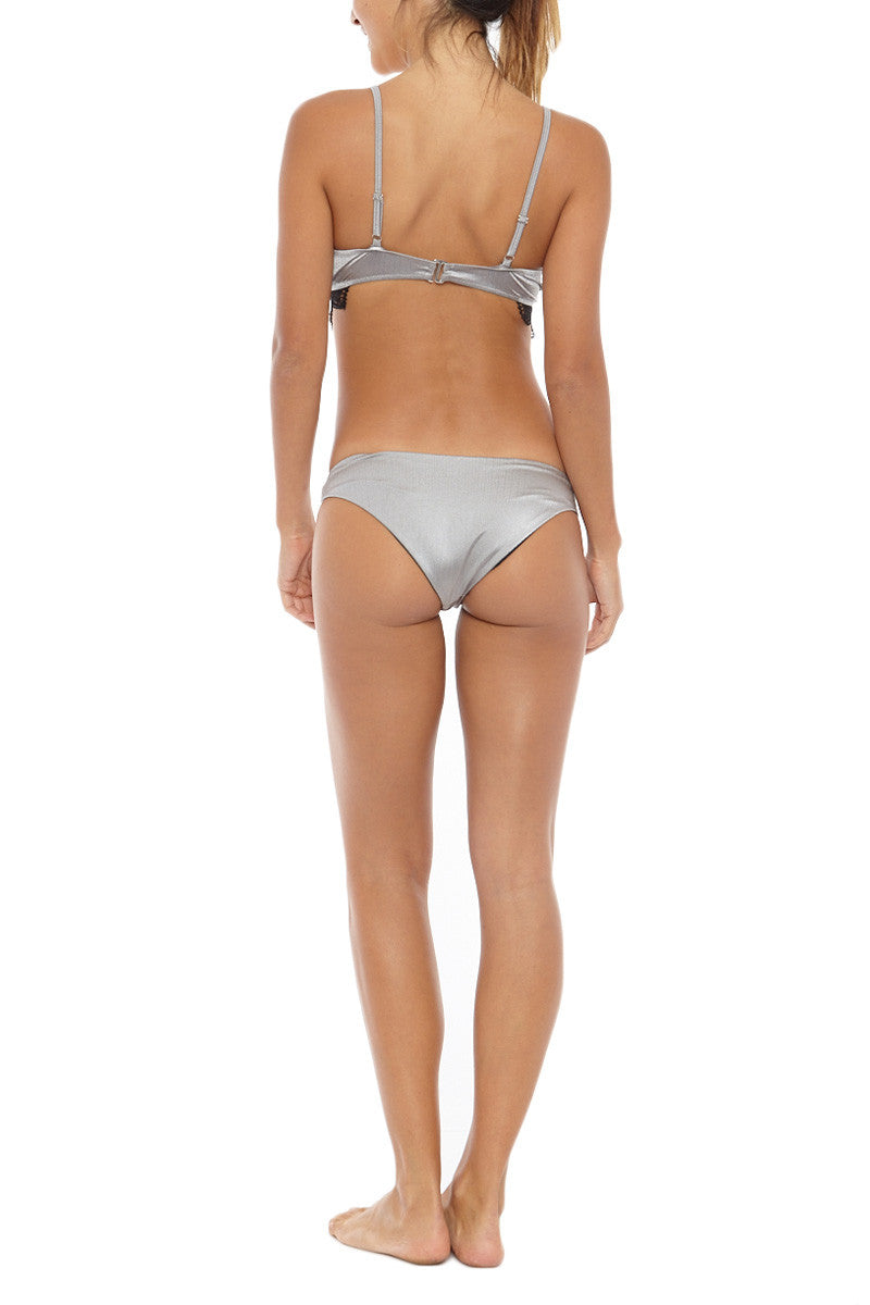 LIRA Jamie Everyday Low Rise Cheeky Bikini Bottom - Silver Bikini Bottom | Silver| LIRA Jamie Everyday Low Rise Bikini Bottom - Silver Low-rise wide side strap cheeky bikini bottom in metallic silver. Crafted from smooth brushed nylon texture with a hint of sheen for a luxurious look. Back View