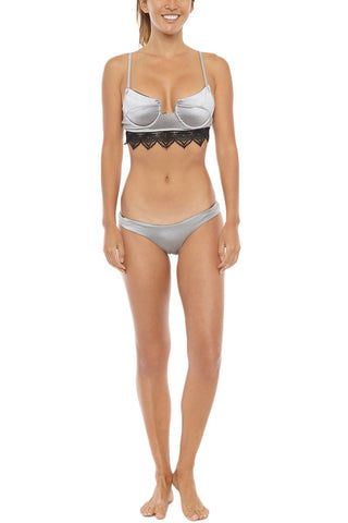 LIRA Jamie Everyday Low Rise Cheeky Bikini Bottom - Silver Bikini Bottom | Silver| LIRA Jamie Everyday Low Rise Bikini Bottom - Silver Low-rise wide side strap cheeky bikini bottom in metallic silver. Crafted from smooth brushed nylon texture with a hint of sheen for a luxurious look. Front View