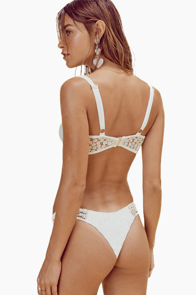 FOR LOVE AND LEMONS Lolita Underwire Bikini Top - Ivory Bikini Top | Ivory| FOR LOVE AND LEMONS Lolita Underwire Bikini Top - Ivory. Features:  Lined Underwire Cups Sheer Daisy Metallic Lace Panels Adjustable Shoulder Straps Rose Gold Back Hook Closure Back View