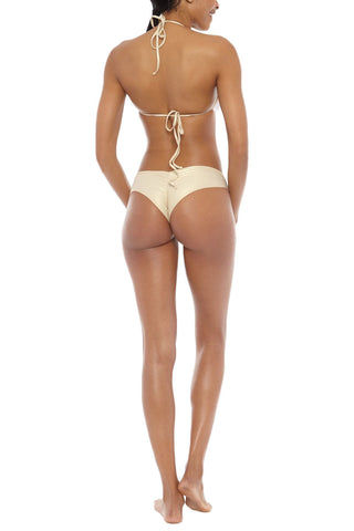 LULI FAMA Sassy Cheeks Lace Overlay Bikini Bottom - White Bikini Bottom | White| Luli Fama Sassy Cheeks Lace Overlay Bikini Bottom - White Sporty style bikini bottoms in a sexy, featuring head-turning, wide criss-cross waist band. Moderate cheeky cut backside flatters your curves and shows off your best assets without revealing too much.   The lace textured fabric is fully lined for a durable and comfortable fit. Back View