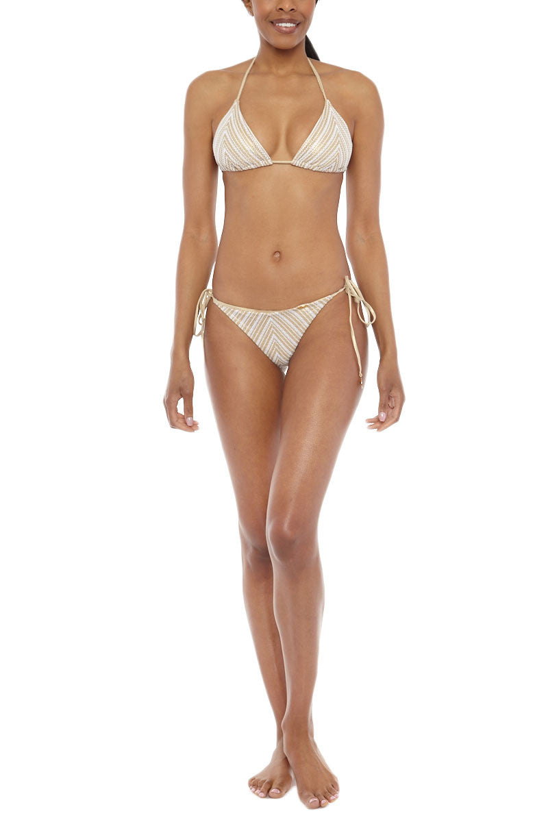 LULI FAMA Halter Triangle Bikini Top - White & Gold Chevron Print Bikini Top | White & Gold Chevron Print| Luli Fama Halter Triangle Bikini Top - White & Gold Chevron Print * Beautiful triangle bikini top with adjustable halter straps  adjustable ties Striped chevron print with gold lame threading creates an elevated and feminine profile. * Padded cups add support and shaping. Front View