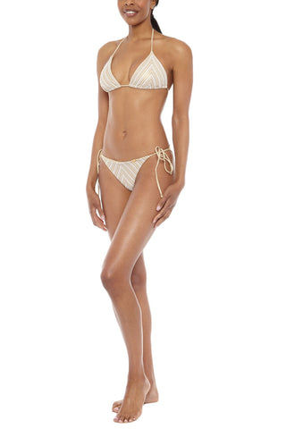 LULI FAMA Halter Triangle Bikini Top - White & Gold Chevron Print Bikini Top | White & Gold Chevron Print| Luli Fama Halter Triangle Bikini Top - White & Gold Chevron Print * Beautiful triangle bikini top with adjustable halter straps  adjustable ties Striped chevron print with gold lame threading creates an elevated and feminine profile. * Padded cups add support and shaping. Side View
