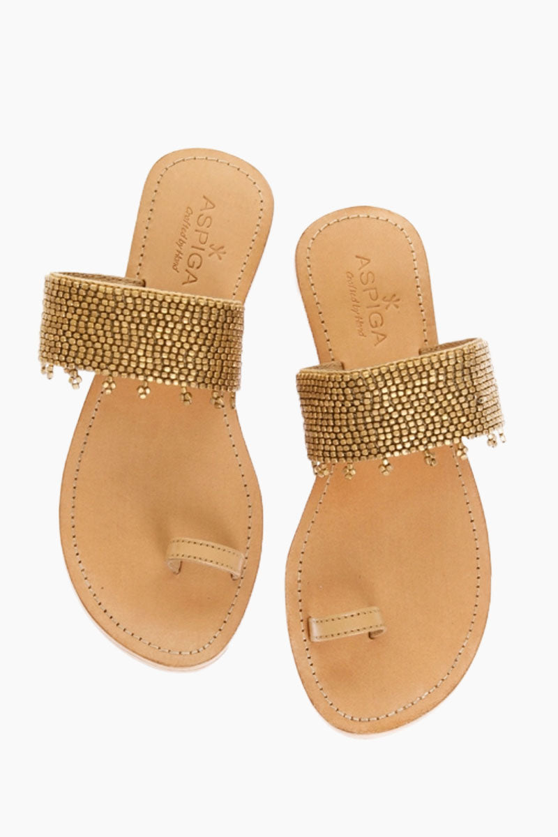 ASPIGA Luna Sandals - Gold Sandals | Gold| Aspiga Luna Sandals - Gold Toe loop style Over the foot strap embellished metal beading  Flat flexible rubber sole Genuine tan leather Hand crafted in Kenya Front View