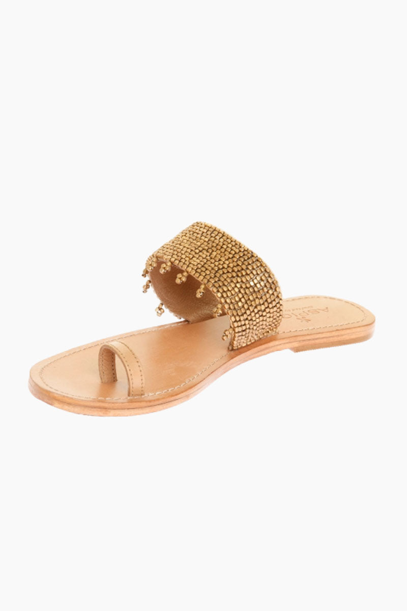 ASPIGA Luna Sandals - Gold Sandals | Gold| Aspiga Luna Sandals - Gold Toe loop style Over the foot strap embellished metal beading  Flat flexible rubber sole Genuine tan leather Hand crafted in Kenya Side View