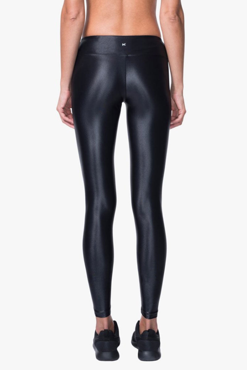 KORAL Lustrous Mid Rise Leggings - Black Leggings |  Black| Koral Lustrous Mid Rise Leggings - Black. Features:  Figure-forming legging Cropped just above the ankle H20-Friendly Recommended for medium performance Back View