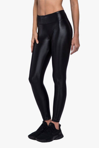 KORAL Lustrous High Rise Leggings - Black Leggings |  Black| Koral Lustrous High Rise Leggings - Black. Features:  Figure forming legging Cropped just above the ankle H20-Friendly Recommended for medium performance Made in USA Front View