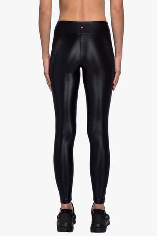 KORAL Lustrous High Rise Leggings - Black Leggings |  Black| Koral Lustrous High Rise Leggings - Black. Features:  Figure forming legging Cropped just above the ankle H20-Friendly Recommended for medium performance Made in USA Back View