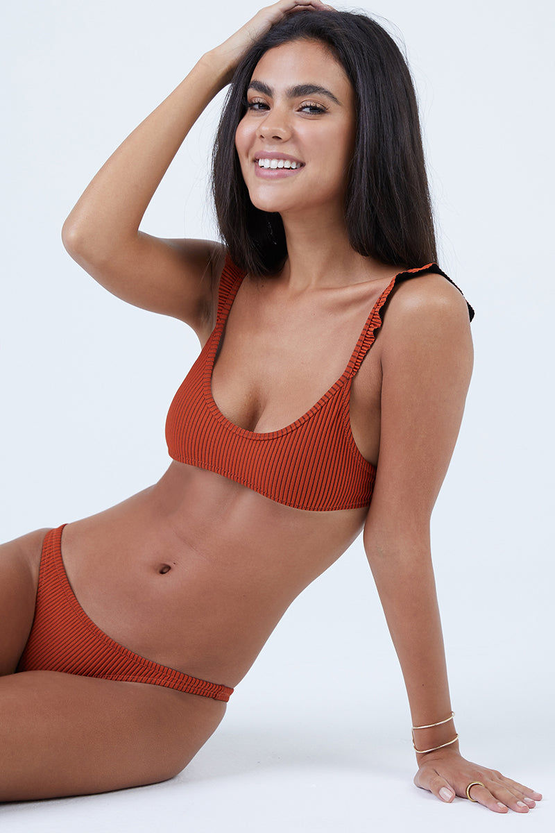 MADE BY DAWN Petal Low Rise Bikini Bottom - Monarch Rib Bikini Bottom | Monarch Rib| Made by Dawn Petal Low Rise Bikini Bottom - Monarch Rib. Features:  Low rise Narrow sided bottom  Orange/black 2 tone rib jacquard 80% Micro-Poly 11% Nylon 9% Spandex Made in the USA Front View