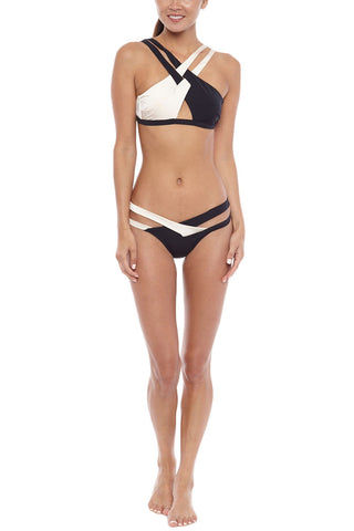 MOEVA Celia Color Block Criss Cross High Neck Bikini Top - Black & White Bikini Top | Black & White | Moeva Celia Color Block Criss Cross High Neck Bikini Top - Black & White Black and white dual colored bikini top is both fun and flirty in equal measure. Intertwined crisscross design creates a unique look that shows off the perfect peek of skin while still supporting your bust. Adjustable straps  Front View