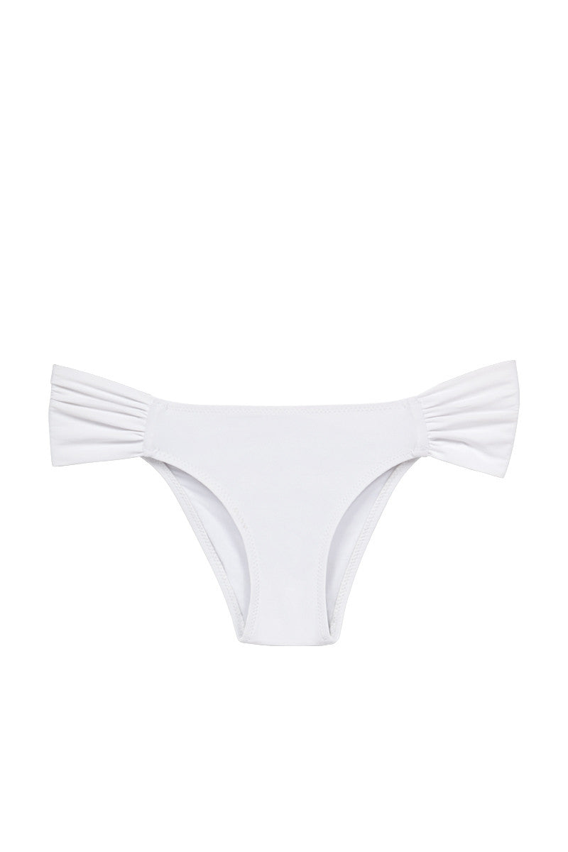 MOEVA Rebecca Ruched Sides Bikini Bottom - White Bikini Bottom | White| MOEVA Rebecca Ruched Sides Bikini Bottom - White Moderately cheeky bikini bottom in White shows off your curves without revealing too much. Laid back low rise front sits below the hips elongating your torso. Wide ruched details at the hips help for shaping. Luscious, fully lined fabric Front View