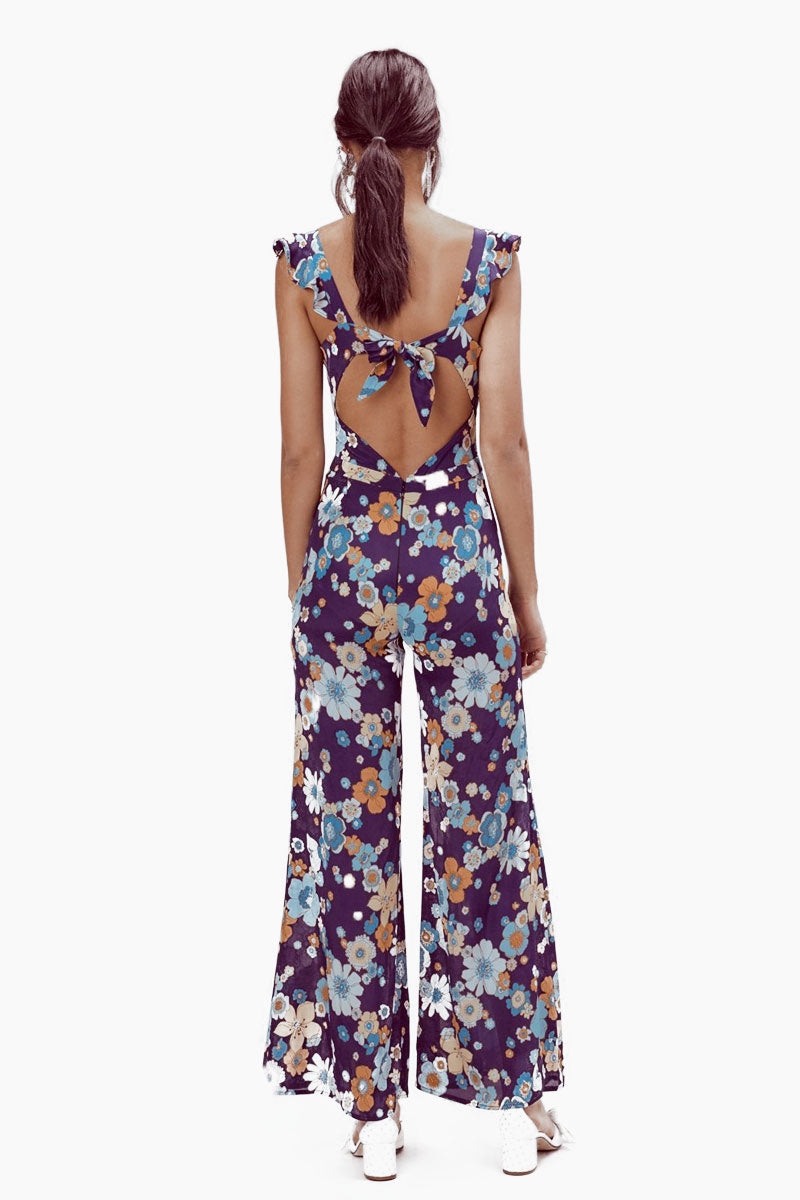 FOR LOVE AND LEMONS Magnolia Ruffled Jumpsuit - Midnight Blossom Jumpsuit | Midnight Blossom| For Love And Lemons Magnolia Ruffled Jumpsuit - Midnight Blossom Features:  Underwire Cups Ruffled Straps Adjustable Back Tie Center Back Invisible Zipper Unlined Dry Clean Only Self: 65% Rayon/35% Viscose Back View