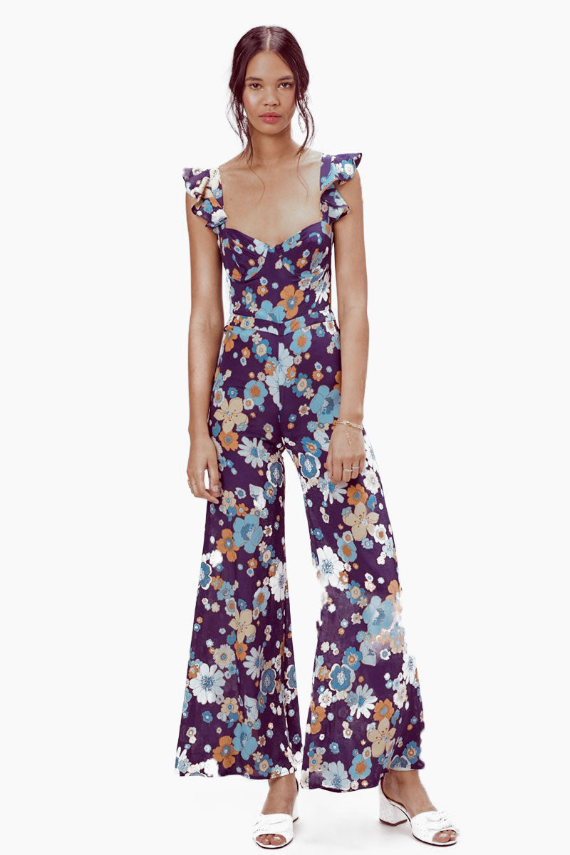 FOR LOVE AND LEMONS Magnolia Ruffled Jumpsuit - Midnight Blossom Jumpsuit   Midnight Blossom  For Love And Lemons Magnolia Ruffled Jumpsuit - Midnight Blossom Features:  Underwire Cups Ruffled Straps Adjustable Back Tie Center Back Invisible Zipper Unlined Dry Clean Only Self: 65% Rayon/35% Viscose Front View