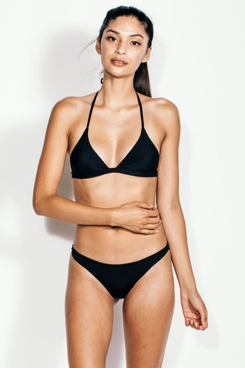 KORE Maia Halter Triangle Bikini Top - Onyx Black Bikini Top | Onyx Black|  KORE Maia Halter Triangle Bikini Top - Onyx Black Classic halter triangle style bikini top in classic black. Adjustable halter straps offer extra bust support and tie behind the neck for the perfect amount of lift. Hook-and-eye closure at the back keeps you secure for worry-free swimming and sunbathing. Crafted from sleek classic black gloss-finish fabric for an edgy, leather-like look. Front View