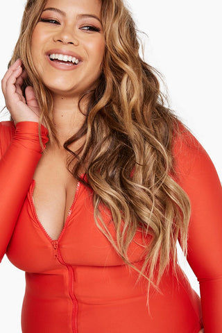 ALPINE BUTTERFLY Marseille Long Sleeve One Piece Swimsuit (Curves) - Rose Red One Piece | Rose Red| Alpine Butterfly Marseille Long Sleeve One Piece Swimsuit (Curves) - Rose Red  Features:  long sleeved one piece Flirty front zipper cheeky back Built-in shelf bra for support Front View