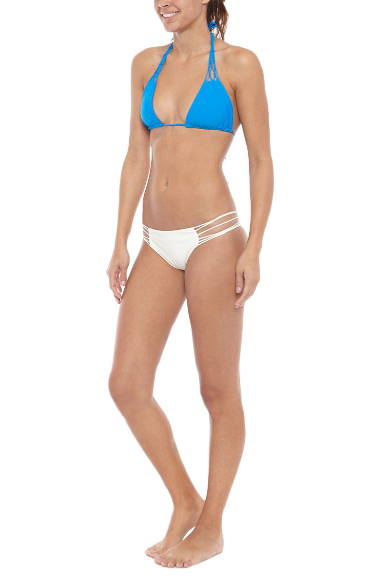 MIKOH Coconuts Adjustable Side String Bikini Top - Tahiti Blue Bikini Top | Tahiti Blue| Mikoh Coconuts Adjustable Side String Bikini Top - Tahiti Blue. Features: Side string for adjustable coverage of cups. Light double lining. Ties at neck and back. View: On model, full front-side view.