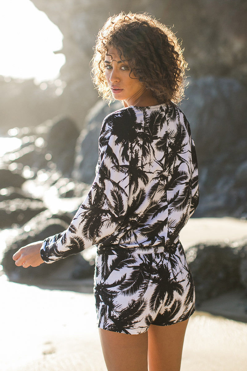 MIKOH Hawaii Long Sleeve Low Cut Romper - Polynesian Palm Print Romper | Polynesian Palm Print| Mikoh Hawaii Long Sleeve Low Cut Romper - Polynesian Palm Print Features: Drawstring cinches at drop waist. Optional button closer on front keyhole. Cuffed 3/4 sleeves. Semi-sheer. Front View