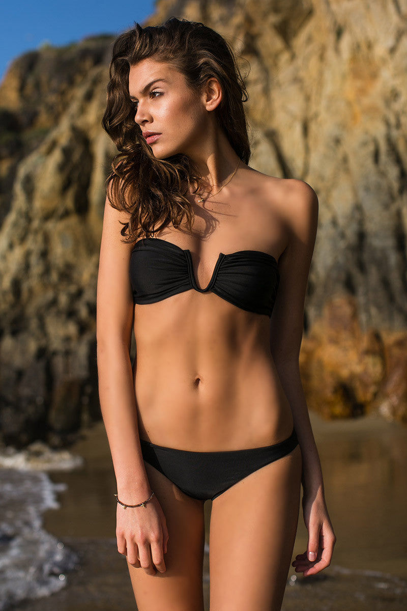 MIKOH Reunion V-Wire Bandeau Bikini Top - Night Black Bikini Top | Night Black| Mikoh Reunion V-Wire Bandeau Bikini Top - Night Black Bandeau Strapless V wire Light boning in sides for support Light double lining 80% Nylon, 20% Spandex Front View