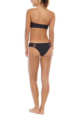 MIKOH Sydney Cut Out Bandeau One Piece Swimsuit - Night Black One Piece | Night Black | Mikoh Sydney Cut Out Bandeau One Piece Swimsuit - Night. Features: Strapless bandeau one piece. Cut out knots details at center and hips. Moderate rear coverage. Fully lined. Back View