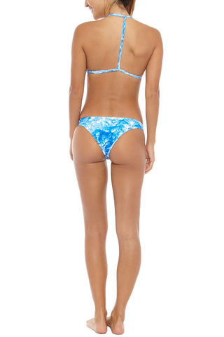 MIKOH Uluwatu T-Back Bralette Bikini Top - Whitewater Fiji Blue Tie Dye Print Bikini Top | Whitewater Fiji Blue Tie Dye Print| Mikoh Uluwatu T-Back Bralette Bikini Top - Whitewater Fiji Blue Tie Dye Print Bralette T-strap racerback Double fabric front and multi string back Pull over 80% Nylon, 20% Spandex Back View