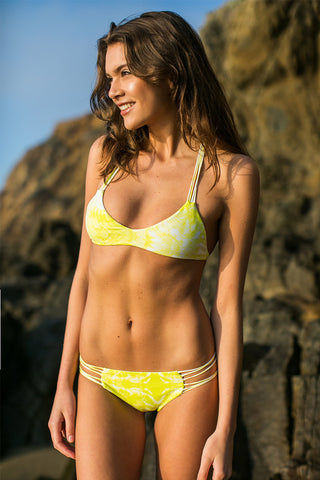 MIKOH Kapalua Stringy Classic Bikini Bottom - Whitewater Plumeria Yellow Tie Dye Print Bikini Bottom | Whitewater Plumeria Yellow Tie Dye Print| Mikoh Kapalua Strappy Classic Bikini Bottom - Whitewater Plumeria Yellow Tie Dye Print. Features: Multiple string sides, elastic stretch fit, fully lined. Front View