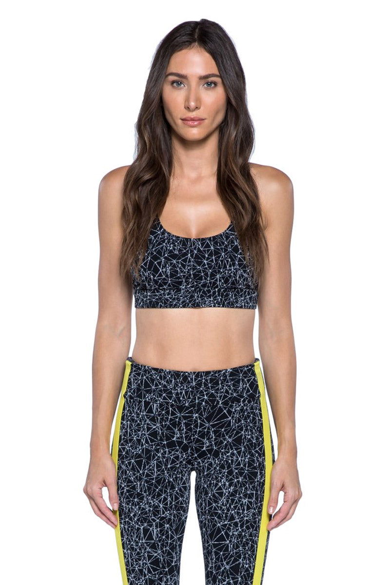 KORAL Fame Criss-Cross Sports Bra - Molecular Black Activewear | Molecular Black| KORAL Molecular Fame Sports Bra Sports bra with removable pads Contrast criss-cross strap detail at back Moderate coverage Meant for high performance Machine wash cold, inside out with like colors; No bleach; Tumble dry low MADE IN USA Front View