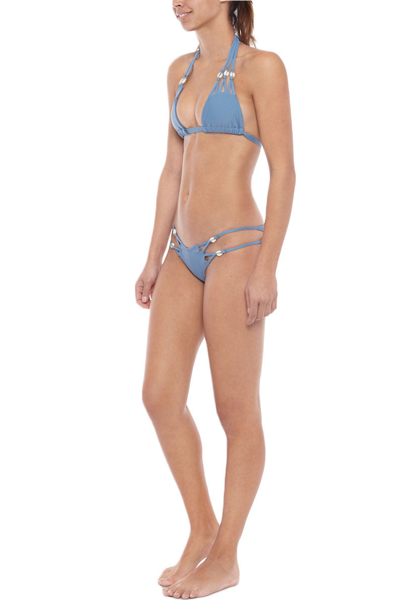 MONTCE SWIM Syd Puka Shell Brazilian Bikini Bottom - Hampton Blue Bikini Bottom | Hampton Blue| Montce Swim Syd Puka Shell Brazilian Bikini Bottom - Hampton Blue. Features: Scrunch bottom. Strappy sides. Sea shell details. Cheeky coverage. Side View