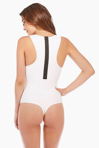 KORE Mykonos Zipper Racerback One Piece Swimsuit - Icy White One Piece | Icy White| KORE Mykonos Zipper Racerback One Piece Swimsuit - Icy White Scoop neck tank style racerback one piece swimsuit in bright white. Wide, fixed tank-style shoulder straps stay secure while swimming and sunbathing. Classic black contrasting zipper closure Back View