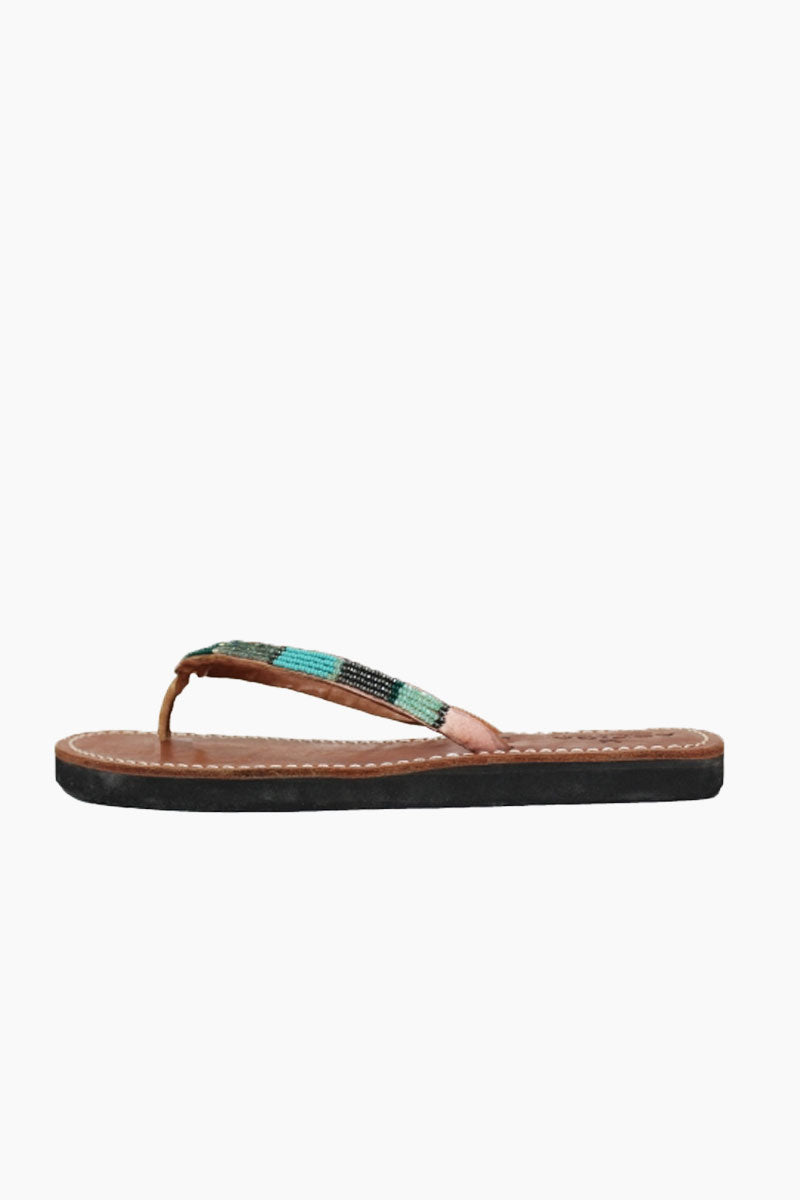ASPIGA Naisha Sandals - Emerald Sandals | Emerald| Aspiga Naisha Sandals - Emerald Classic flip flop style Intricate hand beaded detailing in shades metallic greens, aqua and silver Soft flexible rubber sole for extra comfort Genuine tan leather upper Contrast white stitching Hand crafted in Kenya Side View