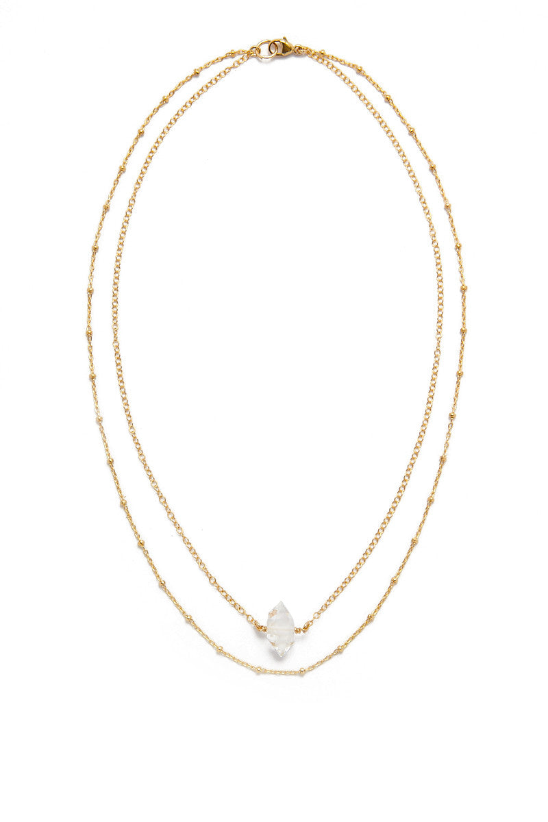 BLAINE BOWEN Netherland Layered Choker - Gold Jewelry   Gold  Blaine Bowen Netherland Layered Choker - Gold  Gold chain layered choker with rough crystal quartz.  Made of 14k gold filled chain with a faceted AAA quartz stone. Front View