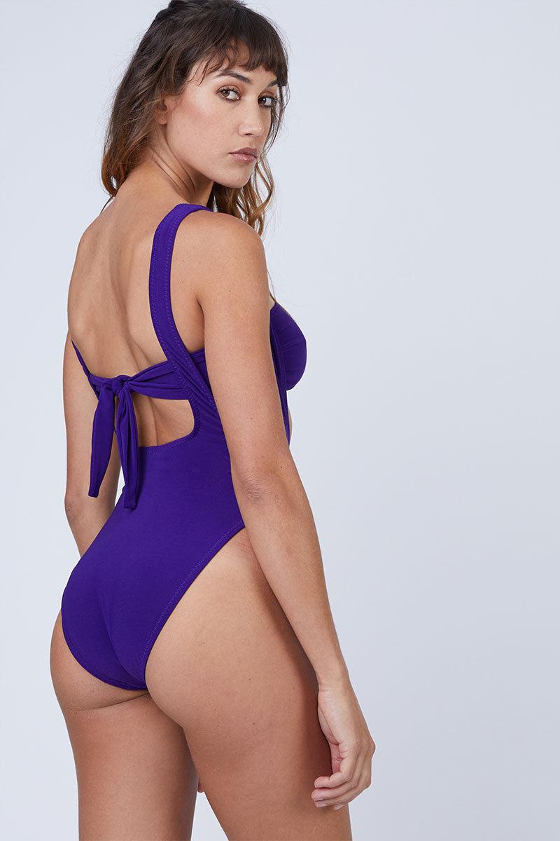 NORMA KAMALI Suspender Marissa Bikini Bottom - Purple Bikini Bottom | Purple| Norma Kamali Suspender Marissa Bikini Bottom - Purple Deep scoop front & back cut out  Suspender straps Low cut sides  High cut leg  Cheeky coverage  Back View