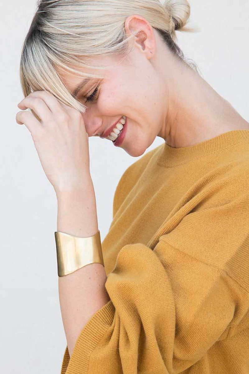 SOKO JEWELRY Organic Flex Cuff Bracelet - Brass Jewelry | Brass| Soko Jewelry Organic Flex Cuff - Brass Asymmetric thick cuff Recycled polished brass Handcrafted in Kenya Front View