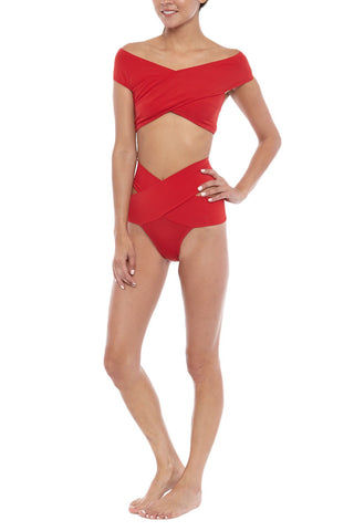 OYE SWIMWEAR Lucette High Waisted Bikini Bottom - Red Bikini Bottom | Red| Oye Swimwear Lucette High Waisted Bikini Bottom - Red. Features: Figure-shaping high-waisted bikini bottom. Statement criss-cross design smooths figure and sculpts curves. Moderate seat coverage. Deep red color is perfect for every skin tone. Coral-peach color is best with warm skin tones. Adjustable: fold down the waistband for a low-rise style. Suitable for wide hips. Pair with criss-cross Lucette bikini top to form the perfect hourglass figure. Add a sheer high-waisted skirt for beach-to-bar style.