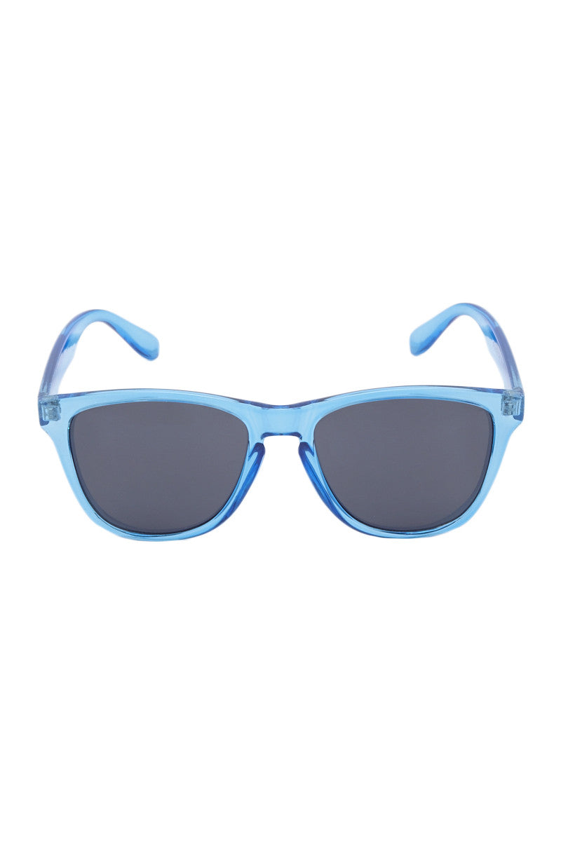 SURREAL SUNGLASSES Classic Sunglasses - Transparent Blue/Gray Sunglasses | Transparent Blue| Surreal Sunglasses Classic Sunglasses - Transparent Blue/Gray Lightweight frame  High quality REVO coated Lens  Full UV A/B protection Front View