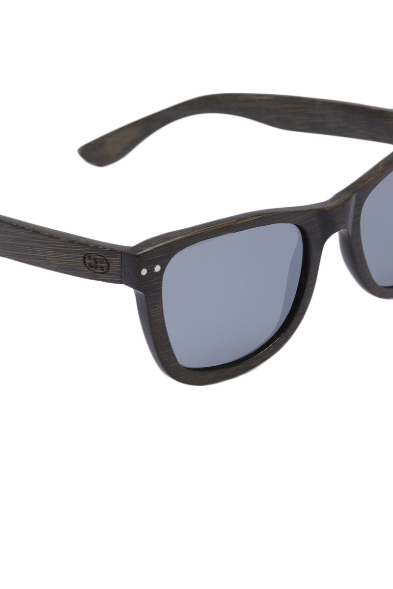 SURREAL SUNGLASSES Floating Full Bamboo Sunglasses - Charcoal Black/Gray Sunglasses | Charcoal Black/Gray| Surreal Sunglasses Floating Full Bamboo Sunglasses - Charcoal Black/Gray 100% Lightweight natural and eco-friendly bamboo frame Float in water  Scratch resistant REVO coated polarized lens  Full UV A/B protection Front View
