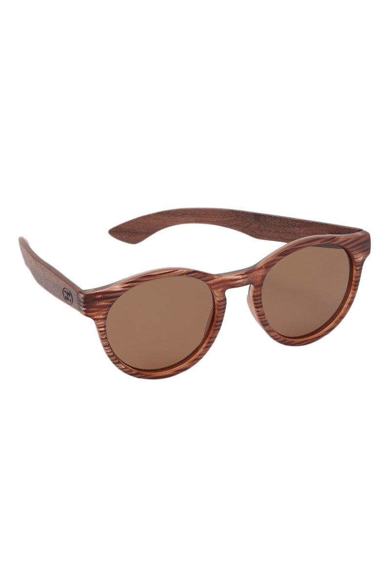 SURREAL SUNGLASSES Premium Bubinga Wood Temple Sunglasses - Brown Sunglasses | Brown| Surreal Sunglasses Premium Bubinga Wood Temple Sunglasses - Brown 100% Lightweight natural eco-friendly Bubinga wood Temples  Light weight plastic frame Scratch Resistant polarized lens Full UV A/B protection  Front View