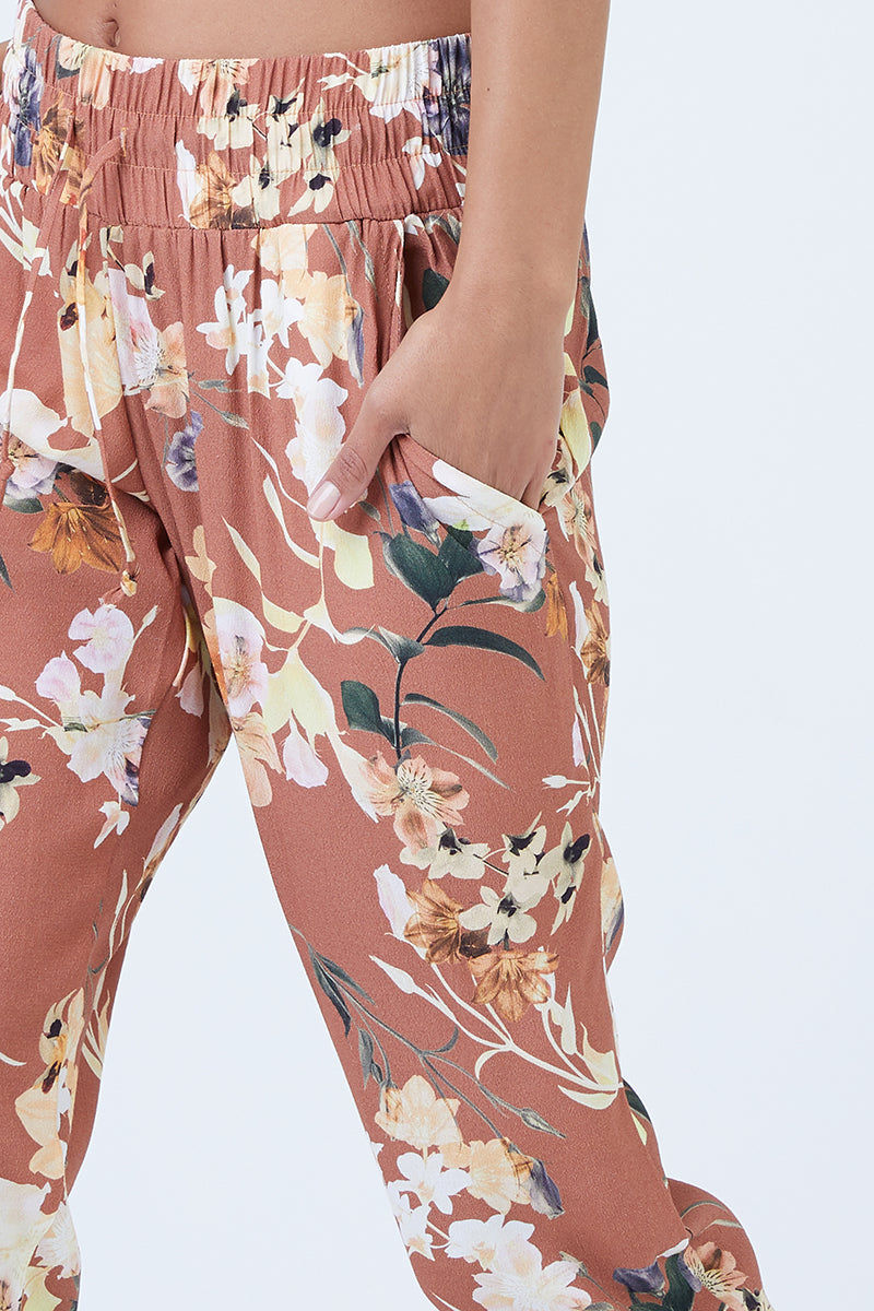 BOYS + ARROWS Over & Out Pants - Dirty Dancing Pants   Dirty Dancing  Boys + Arrows Over & Out Pants - Dirty Dancing * Orangerelaxed fit low-rise pants with elastic waistband and drawstring slim, tapered fit drapes in an all overall floral print. Front View