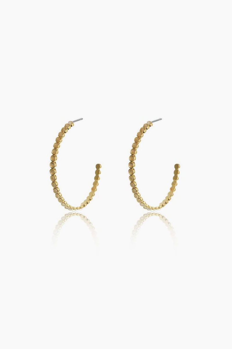 """LUV AJ The Oversized Quartz Stud Hoop Earrings - Gold Jewelry   Gold  Luv Aj The Oversized Quartz Stud Hoops - Gold Front View  Oversized Statement Hoops Quartz stud details Made with Real Crystal Quartz Hoops are 2.5"""" Tall Made from Brass and Crystal Quartz Plated in Gold"""