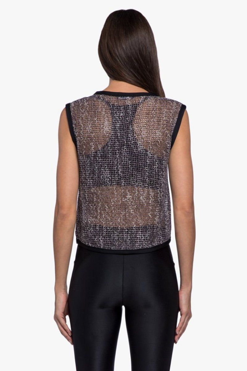 KORAL Phosphenes Plexus Mesh Crop Top - Black Top | Black| Koral Phosphenes Plexus Mesh Crop Top - Black Cropped at natural waist Open mesh is crocheted from a soft and silky yarn Sleeveless Contrast binding along neckline, armholes and waist hem Back View