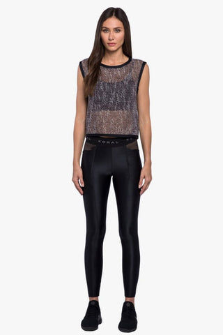 KORAL Phosphenes Plexus Mesh Crop Top - Black Top | Black| Koral Phosphenes Plexus Mesh Crop Top - Black Cropped at natural waist Open mesh is crocheted from a soft and silky yarn Sleeveless Contrast binding along neckline, armholes and waist hem Front View