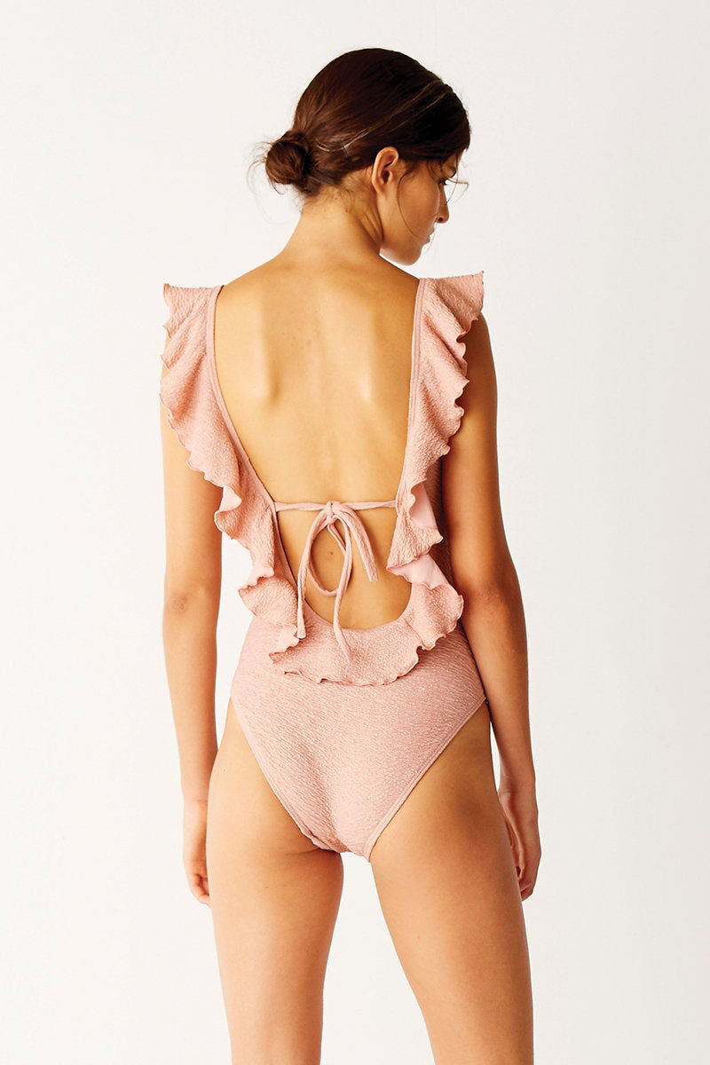 SUBOO Frill Scoop Ruffle One Piece Swimsuit - Pink Sands One Piece | Pink Sands| Suboo Frill Scoop Ruffle One Piece Swimsuit - Pink Sands. Features:  Designed to elongate your frame! Rose gold metallic textured fabric Feminine frills along the shoulder strap Back tie for ultimate comfort Open back Made in Australia Fabric Composition: Polyester/Elastane Outer | Nylon/Elastane Lining Back View