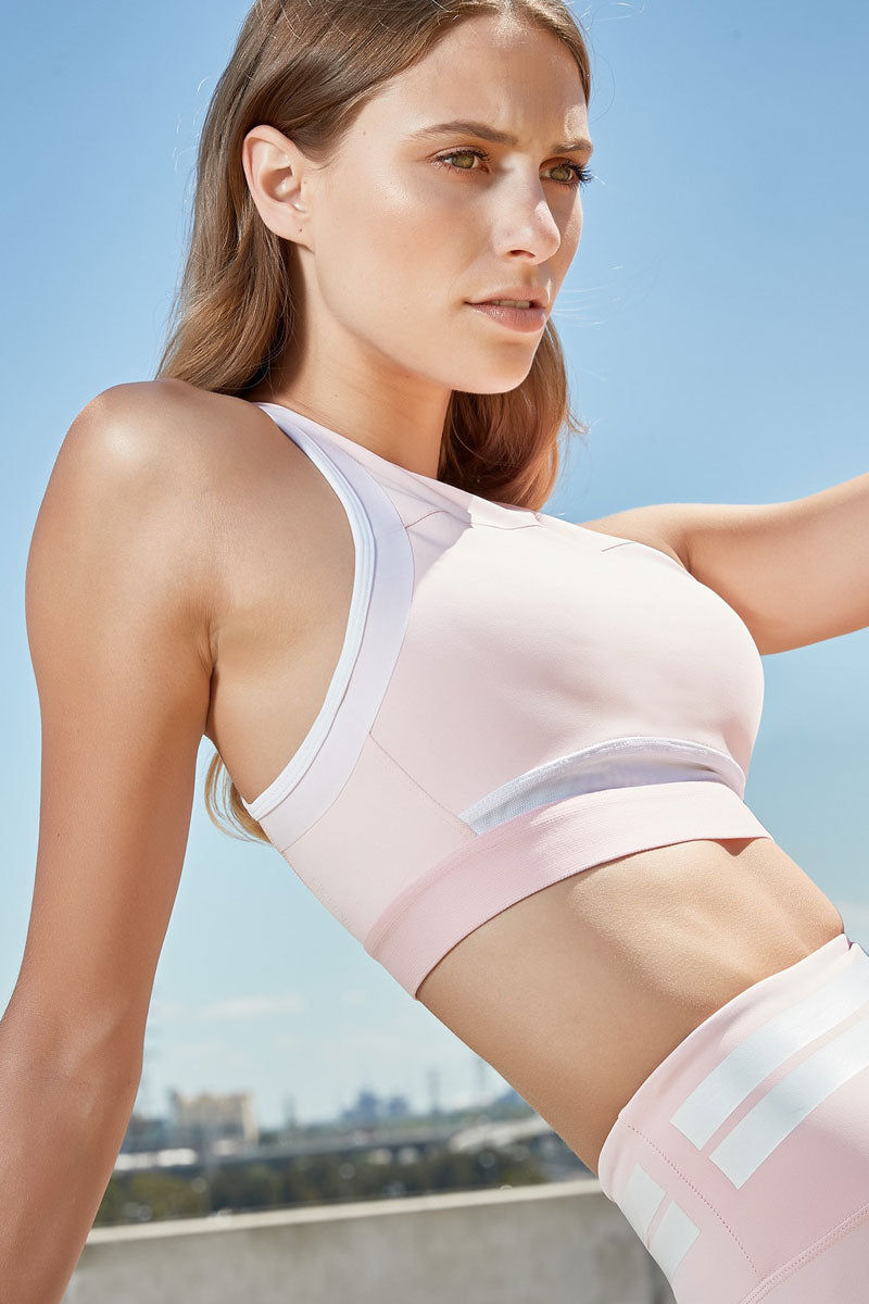 LILYBOD Petta Sports Bra - Coral Blush Activewear | Coral Blush| Lilybod Petta Sports Bra - Coral Blush. FEATURES:  Feminine lux with an understated edge that easily transitions you from studio to street. Full coverage and optimum support Seamless technology contrast armband Power-mesh back & front panels Our signature 73%Poly/27%Spandex soft-touch fabric. View:  Front View.