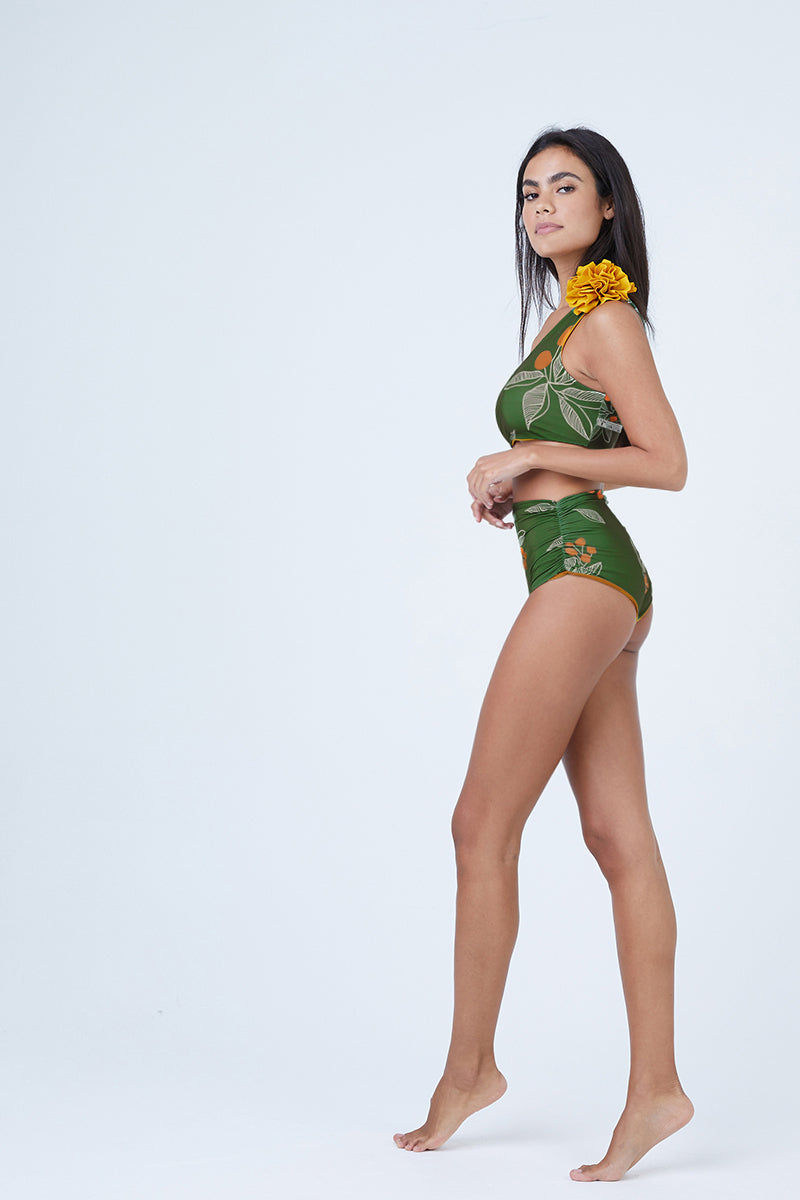 JUAN DE DIOS Pijiba Reversible One Shoulder Bikini Top - Green/Mustard Bikini Top | Mustard/Green| Juan De Dios Pijiba Reversible One Shoulder Bikini Top - Mustard/Green. Features: One shoulder bikini top Removable flower on shoulder Asymmetric neckline 80% Polyamide, 20% Elastane, Xtra Life Certificated Lycra, UPF +50 Front View