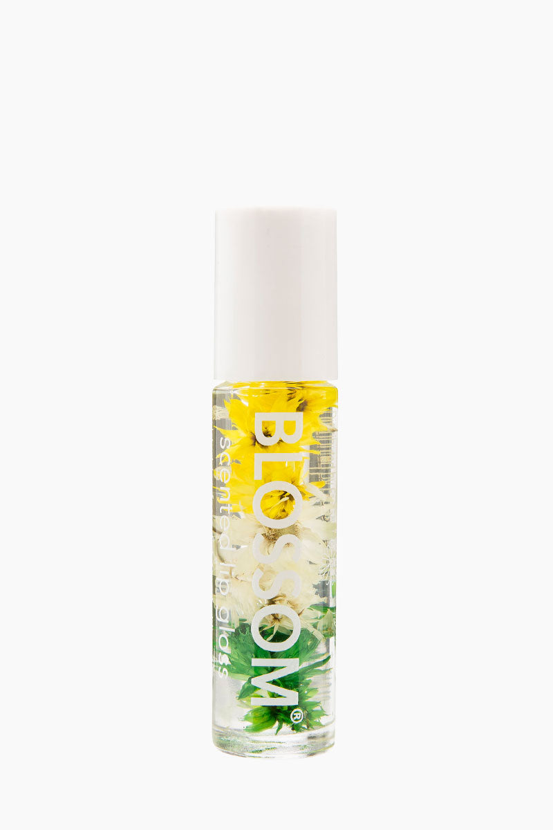 BLOSSOM Roll On Lip Gloss - Pineapple Beauty | Pineapple | Blossom Roll On Lip Gloss - Pineapple Roll on lip gloss with a pineapple scent  Infused with natural dried flowers  Rolls on clear for a subtle shine  Housed in a sleek rollerball glass bottle Made in USA Front View