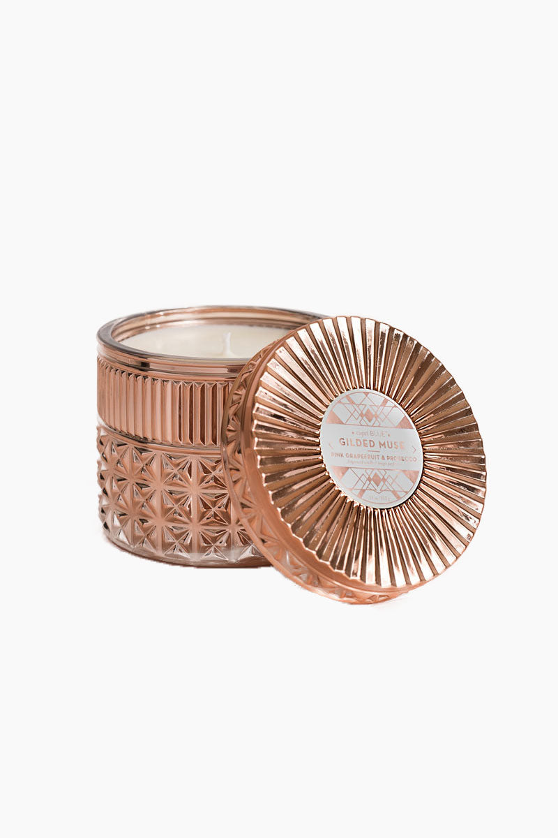 CAPRI BLUE Pink Grapefruit & Prosecco 11oz Rose Gold Jar Candle Home | NC| Pink Grapefruit & Prosecco 11oz Rose Gold Jar Rose Gold Metallic Jumbo Faceted Jar With Pink Grapefruit, Mimosa Flower, and Violet Scented Candle