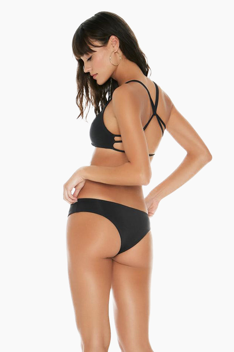 L SPACE Hartley Twist Front Top - Black Bikini Top |  Black | L Space Hartley Twist Front Top - Black Twist detail at center front Twisted cross back Double straps 80% nylon, 20% spandex Made in the USA