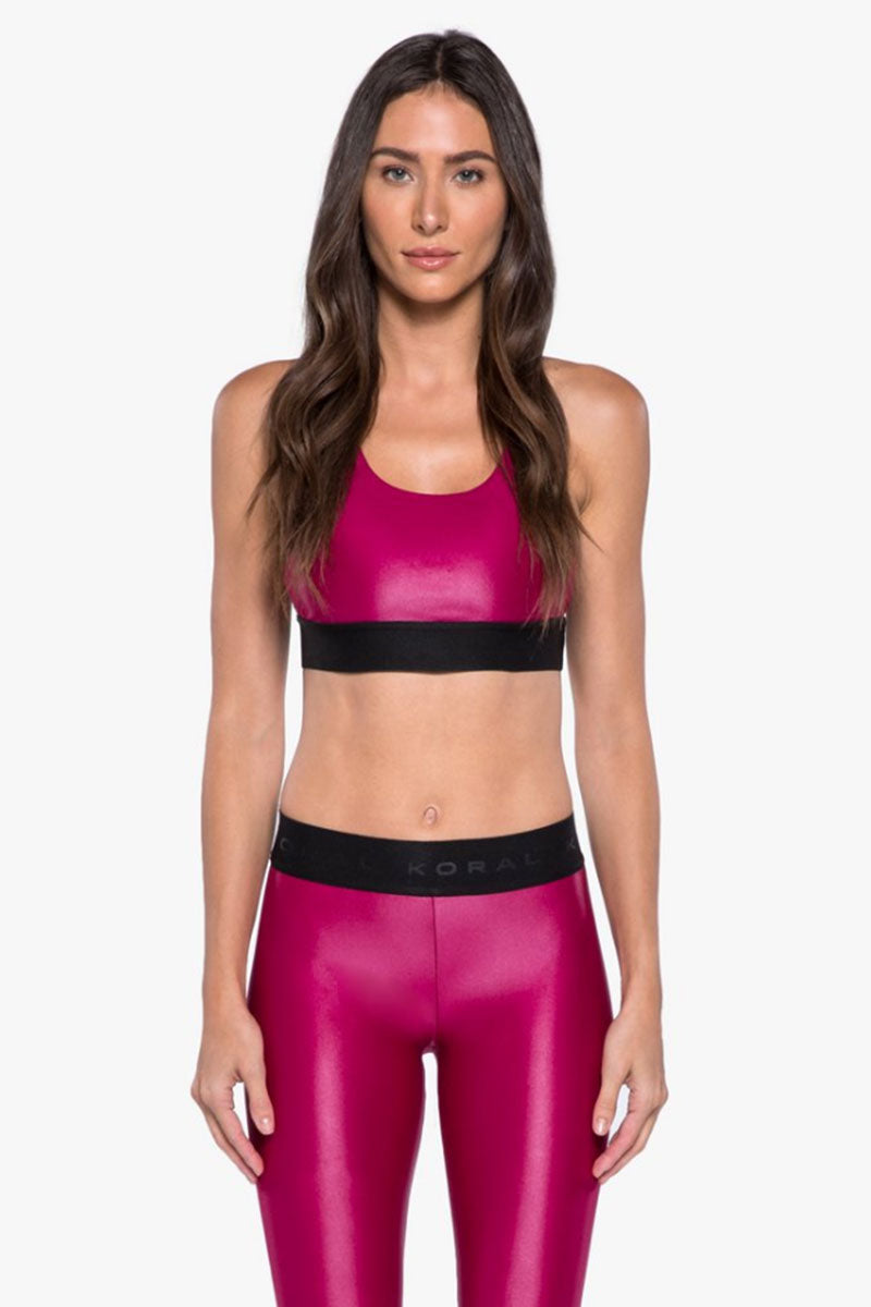 KORAL Plyo Strappy Sports Bra - Azalea Activewear   Azalea  Koral Plyo Strappy Sports Bra - Azalea. Features:  Sports bralette with strappy back details. Moderate coverage. Removable pads. Meant for High performance. Fabric 1: Infinity - 79% Polyamide, 21% Xtra Life Lycra Sport  Lining: Powermesh - 72% Nylon, 28% Spandex Machine wash cold, inside out with like colors; No bleach; Tumble dry low.  MADE IN USA Front View
