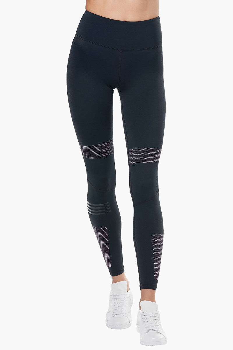 LILYBOD Polly Leggings - Blue Graphite Activewear | Blue Graphite| Lilybody Polly Leggings - Blue Graphite. Features:  Sleek performance meets super-fresh style in our stunning new Polly legging. High-waisted slimming silhouette Full-length crop designed to sit on or above the ankle Engineered purple graphic dot print Self-color silicon quad stripe right leg only Our signature 73%Poly/27%Spandex soft-touch fabric. View:  Front View.