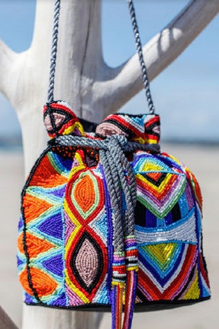 ASPIGA Pouch Bag - Multi Bag | Multi| Aspiga Pouch Bag - Multi Handmade pouch style bag Individually handbeaded Drawstring closure Silver shoulder strap Beaded tassels Front View