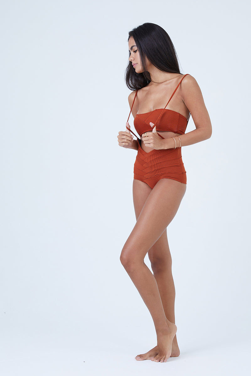 MADE BY DAWN Puzzle Jumper Bandeau Bikini Top - Monarch Rib Bikini Top | Monarch Rib| Made by Dawn Puzzle Jumper Bandeau Bikini Top - Monarch Rib. Features:  Strapless bandeau  Asymmetric ribbed detail  49% Polyester, 38% Nylon, 13% Spandex Made in the USA Front View