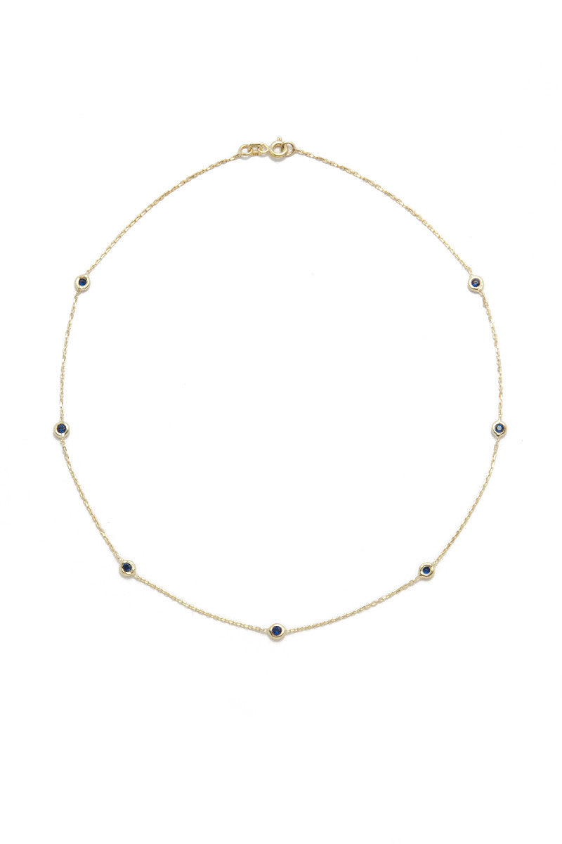 BLAINE BOWEN Quinn Chain Choker - Gold & Sapphire Blue Jewelry | Gold & Sapphire Blue| Blaine Bowen Quinn Chain Choker - Gold & Sapphire Blue  Gold chain choker necklace with sapphire accents. Made with 14k gold filled chain and clear cubic zirconia accents for a touch of shine. Front View